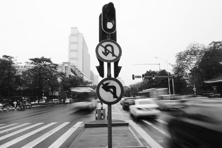 Number Speed Blurred Motion Tree Communication Transportation Speed Limit Sign Day Motion Road Road Sign Outdoors Clock No People Time Clear Sky City Minute Hand Clock Face