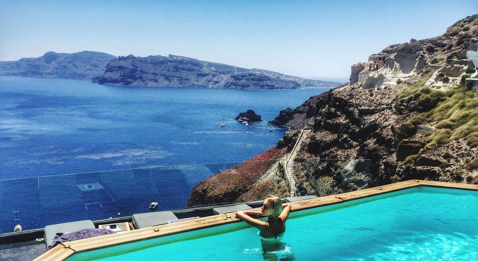 Woman on swimming pool against sea