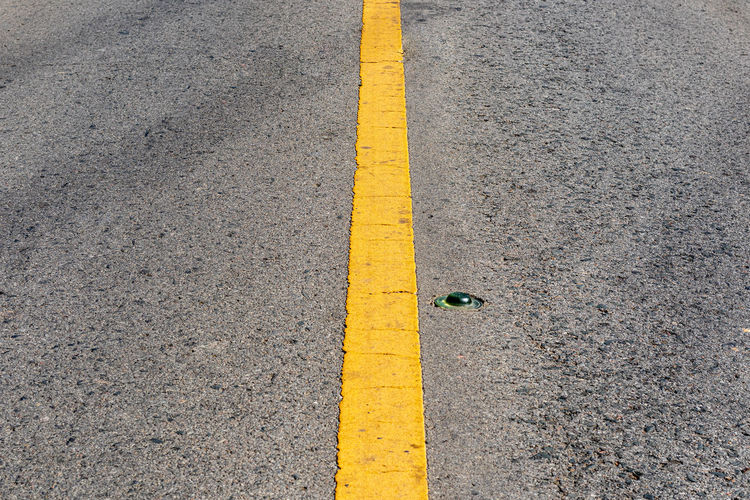 High angle view of yellow line on road