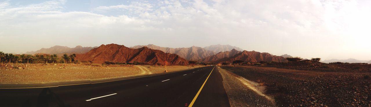 Empty Road Along Barren Landscape