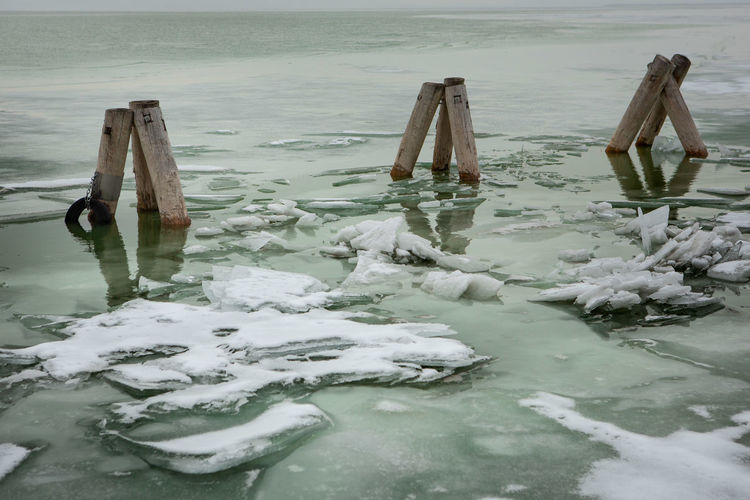 Snow Cold Temperature Winter Water Nature Wood - Material No People Frozen Tranquility Day Beauty In Nature Tranquil Scene Scenics - Nature Ice Non-urban Scene Wooden Post Pier Lake Anchorage