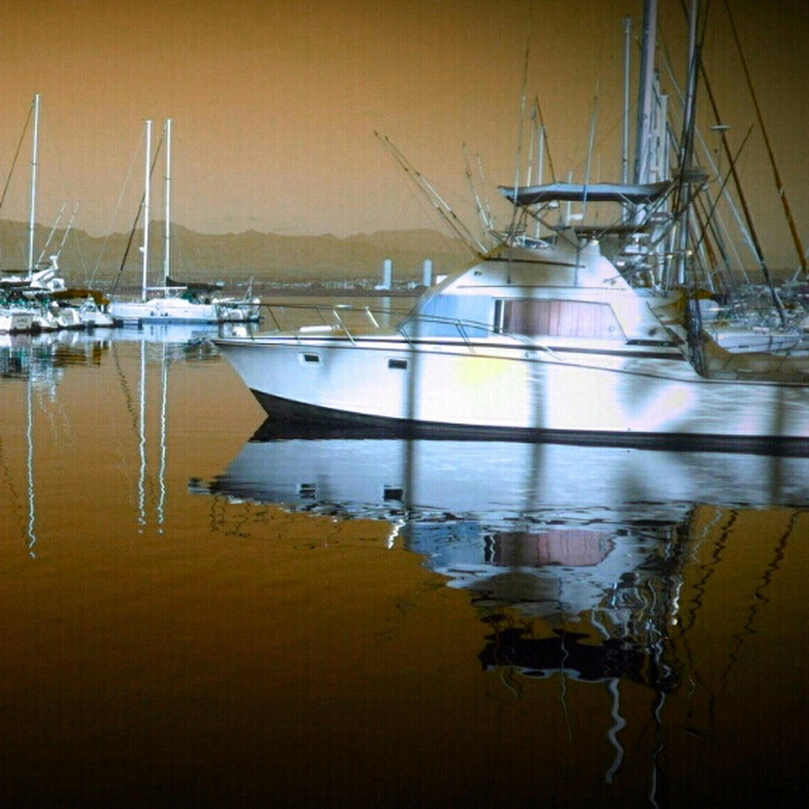 nautical vessel, transportation, moored, boat, mode of transport, water, mast, sea, harbor, reflection, sailboat, sunset, waterfront, lake, nature, no people, travel, outdoors, sky, yellow