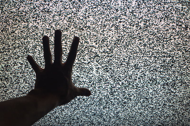 Close-up of person hand against wall