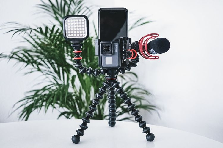 IGTV Vlog Vlogger Black Color Camera Camera - Photographic Equipment Close-up Communication Digital Camera Equipment Focus On Foreground Indoors  No People Photographic Equipment Photography Themes Plant Red Retro Styled Still Life Table Technology Tripod Vloggers