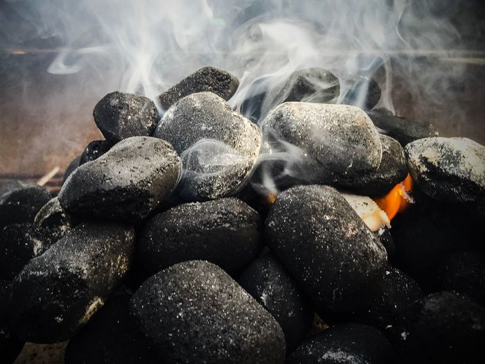 Close-Up Of Smoke Emitting From Coals