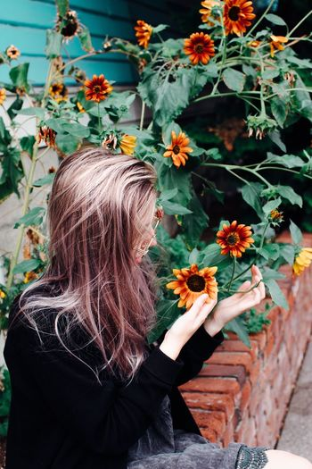 Caught in nature Aesthetics People Flower Flowering Plant Plant One Person Real People Lifestyles Leisure Activity Nature Flower Head Vulnerability  Fragility Women Growth Hairstyle