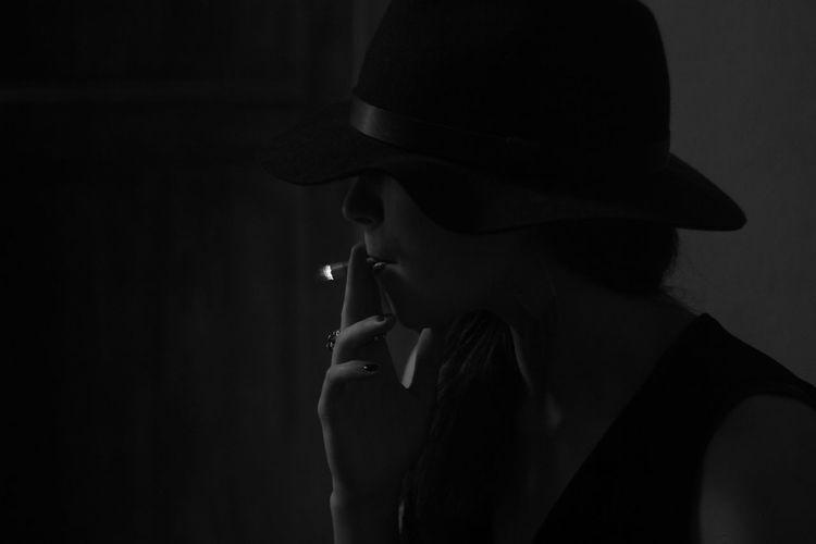 Man smoking cigarette in darkroom