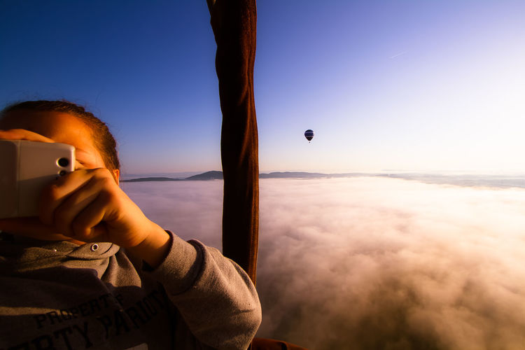 Hot Air Balloon Flying High Foggy Scenics Outdoors Tranquility Horizon Over Water Leisure Activity Lifestyles Sunrise