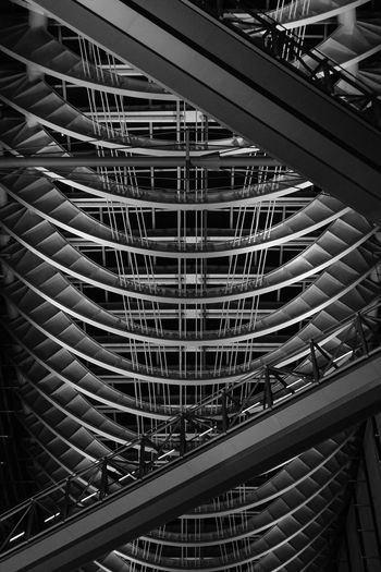 Architectural Feature Architecture Building Built Structure Ceiling City Day In A Row Indoors  Low Angle View Metal Modern No People Office Building Exterior Pattern Railing Repetition Staircase Steps And Staircases Travel Destinations