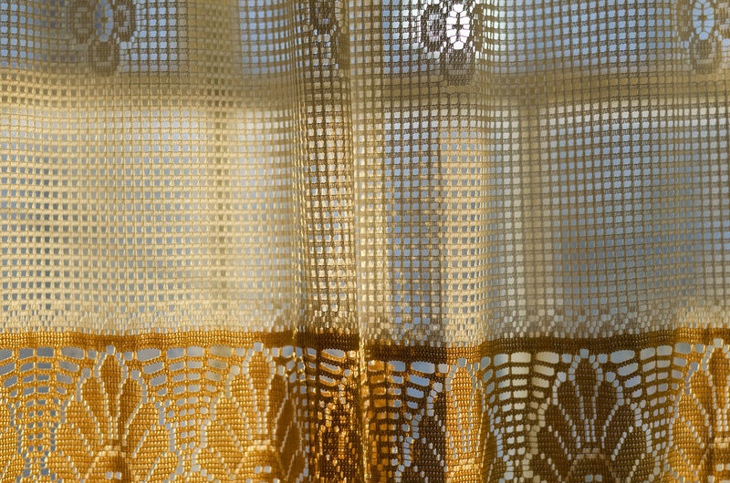 Window with curtains in the evening light abstract background