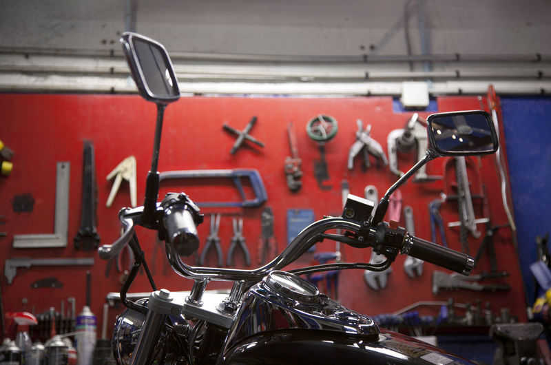 Bikers world, bikers garage, repair tools on a red wall and motorcycle , repairing workshop