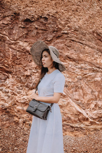 Adult Beautiful Woman Casual Clothing Clothing Contemplation Day Front View Hair Hairstyle Hat Leisure Activity Lifestyles Looking Nature One Person Outdoors Real People Standing Teenager Three Quarter Length Women Young Adult Young Women