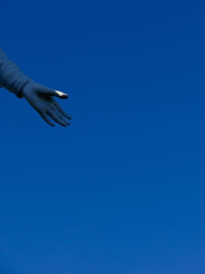 Cropped Image Of Statue Against Clear Blue Sky