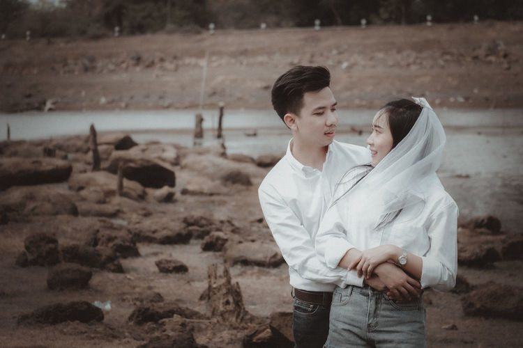 Young couple sitting on land