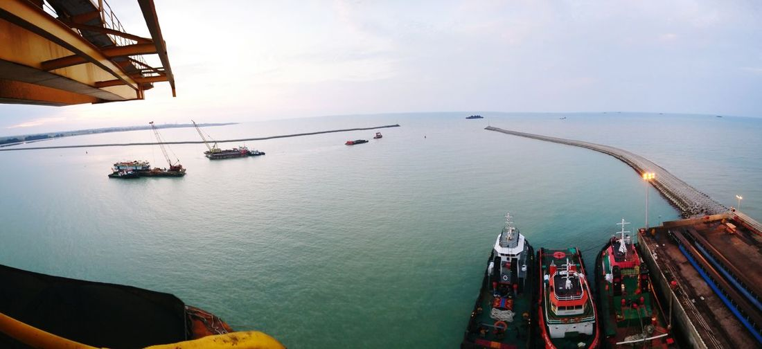 High angle view of harbor at sea against sky