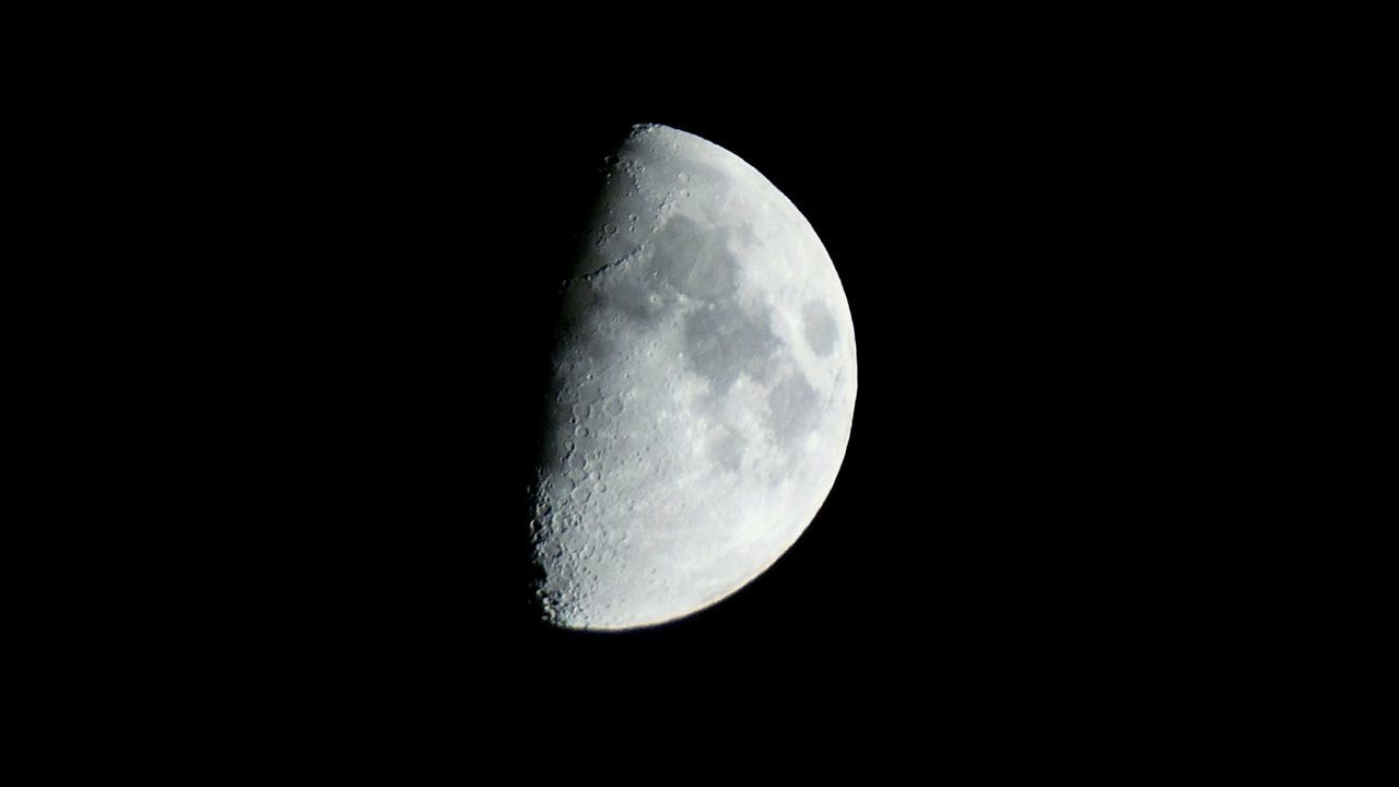 moon, night, astronomy, moon surface, beauty in nature, planetary moon, nature, space exploration, half moon, scenics, tranquility, majestic, tranquil scene, copy space, no people, space, outdoors, discovery, clear sky, sky, low angle view, close-up, satellite view
