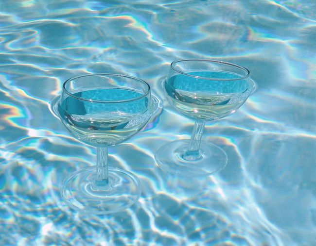 Close-up of wineglasses in water