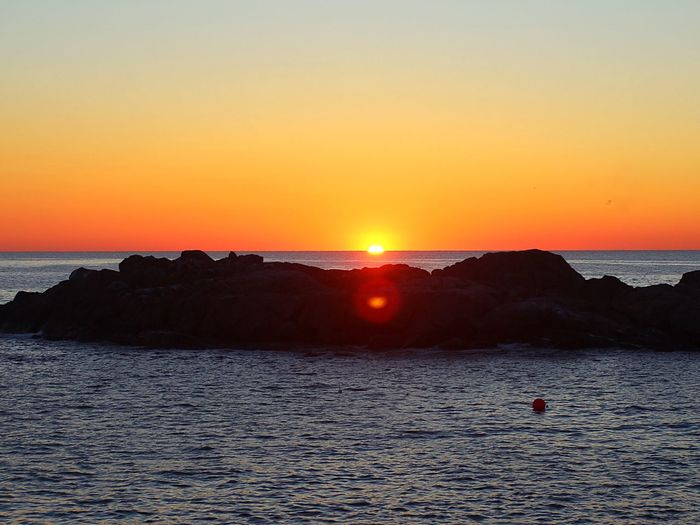 First rays of sunlight at Nubble Lighthouse, York, Maine. Sea Water Nature Beauty In Nature Scenics Tranquil Scene Tranquility Sun Orange Color Silhouette Horizon Over Water Sky Beach Idyllic Outdoors Vacations Sunlight Leisure Activity Waterfront The Week On EyeEm Lost In The Landscape