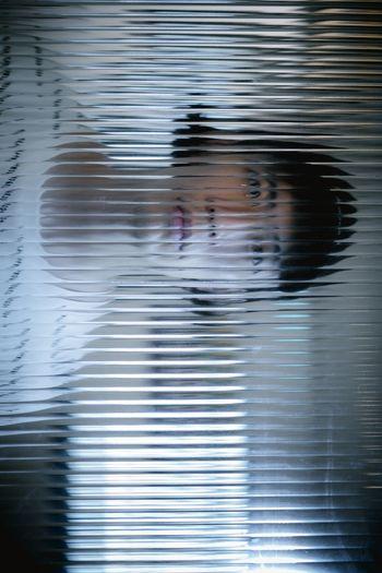 Full frame shot of boy on window