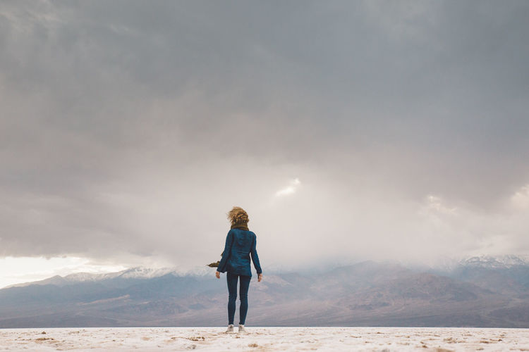 Arid Climate Arid Landscape Bad Water Basin Badwater Basin Beauty In Nature Cloud - Sky Curly Hair Day Death Valley Death Valley National Park Desert Full Length Girl Landscape Leisure Activity Lifestyles Mountain Nature One Person Outdoors Real People Rear View Scenics Sky Standing