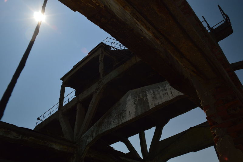 Low angle view of old bridge against sky
