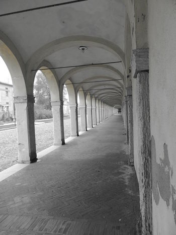 Arcade Arch Arched Architectural Column Architectural Feature Architecture Archway Below Blackandwhite Photography Built Structure Colonnade Column Corridor Day Diminishing Perspective History In A Row No People Passage Prospective Prospective Architecture_bw Streetphotography_bw Prospective Photography Repetition The Way Forward Vanishing Point