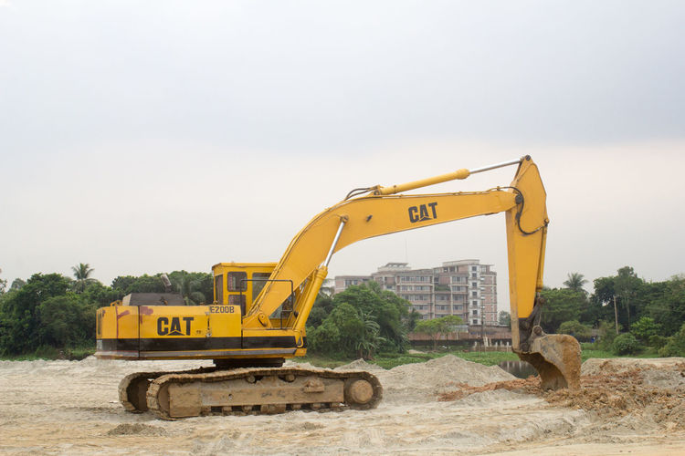 Construction Machinery On Site Against Sky
