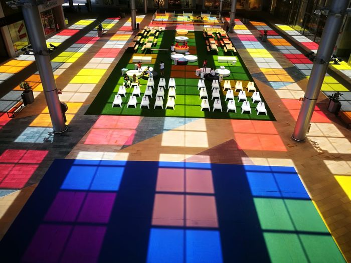High Angle View Of Multi Colored Tiled Floor