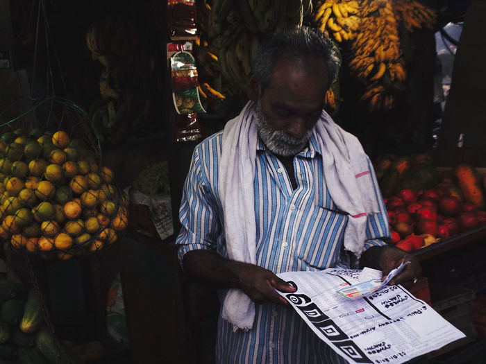 Man standing in a market stall