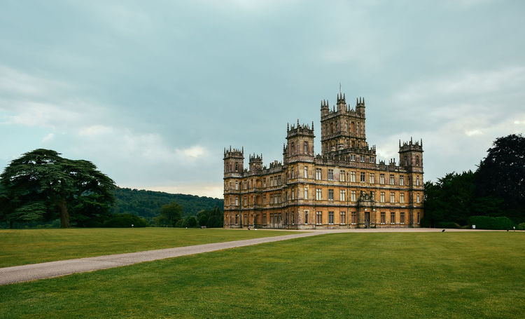 Highclere Castle, England Architecture Building Exterior Built Structure Cloud - Sky Culture Day Downton Abbey Engineering Façade Famous Place Grass Grass Area Green Color Highclere Castle History International Landmark Lawn Medieval National Landmark Outdoors Posh Sky The Past Tourism Travel Destinations