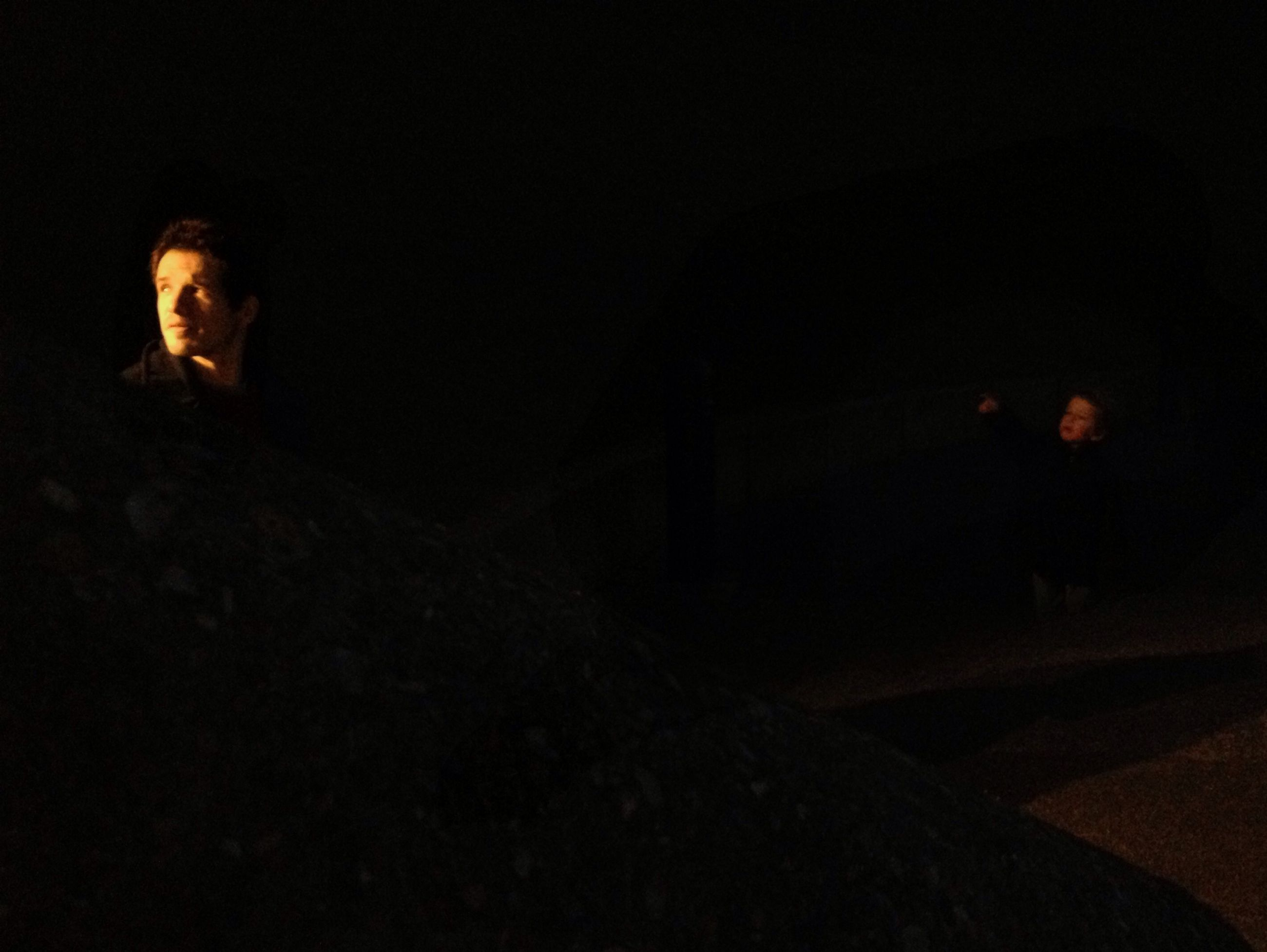 lifestyles, night, leisure activity, young adult, copy space, person, indoors, full length, portrait, casual clothing, young men, standing, looking at camera, dark, three quarter length, sitting, side view