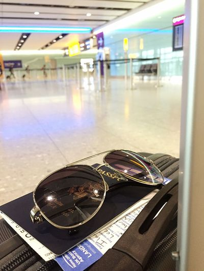 The essentials. #travellife Leisure Activity Lifestyle Travel And Leisure Traveling Photography London Indoors  Illuminated Transportation Incidental People Glasses Reflection Glass - Material Focus On Foreground Architecture Wealth Security Close-up Ceiling Communication Mode Of Transportation Luxury Flooring Sign Protection