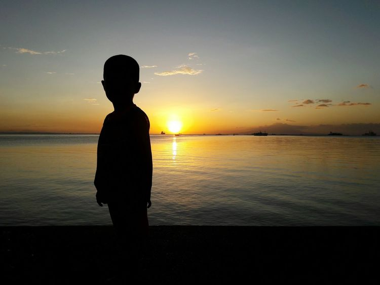 Beginnings of a Little Boy Chance Encounters Street Photography Sunset Beauty In Nature Outdoors Urban Cityscape Little Boy Silhouette Gold Colored One Person Sea Day Eyeem Philippines My Year My View Wander Finding New Frontiers The City Light Welcome To Black EyeEm Diversity Break The Mold