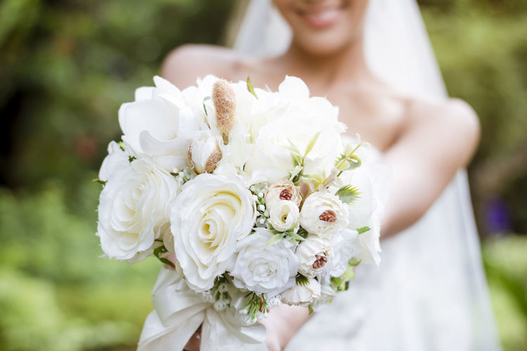 Close-up of white rose holding bouquet