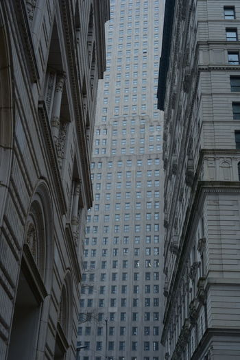 Low angle view of buildings on wall street
