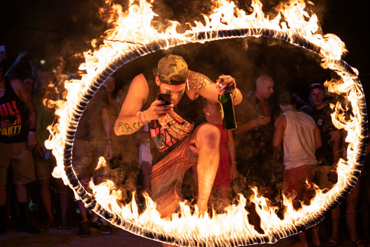 Beer O'clock Men Burning Heat - Temperature Fire Flame Fire - Natural Phenomenon Real People Group Of People Adult Night People Performance Dancing Three Quarter Length Celebration Ring Rope Circle Burning Beer Mobile Phone Colourful Illuminated Glowing Party