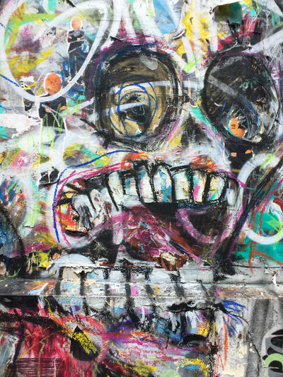 Colorful graffiti art of a skull. Graffiti Art Close-up Day Graffiti Art Multi Colored Outdoors Paint Skull Streetart Teeth