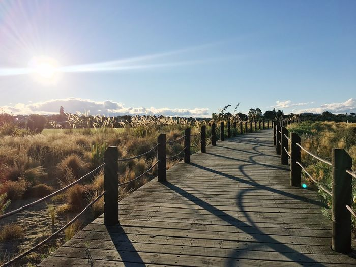 Sunlight Railing Sun Shadow Sunbeam Sky Outdoors Scenics Day The Way Forward Tranquility No People Trail Walk Boardwalk Sunset Golden Chilling Peaceful Bright Path