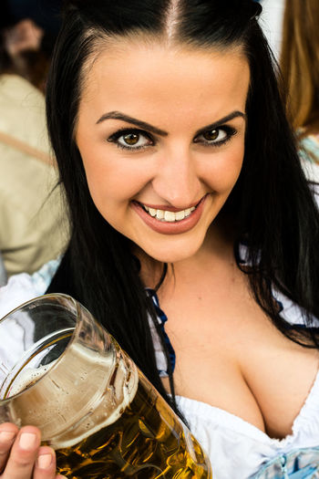 Portrait Of Woman Enjoying Beer At Oktoberfest