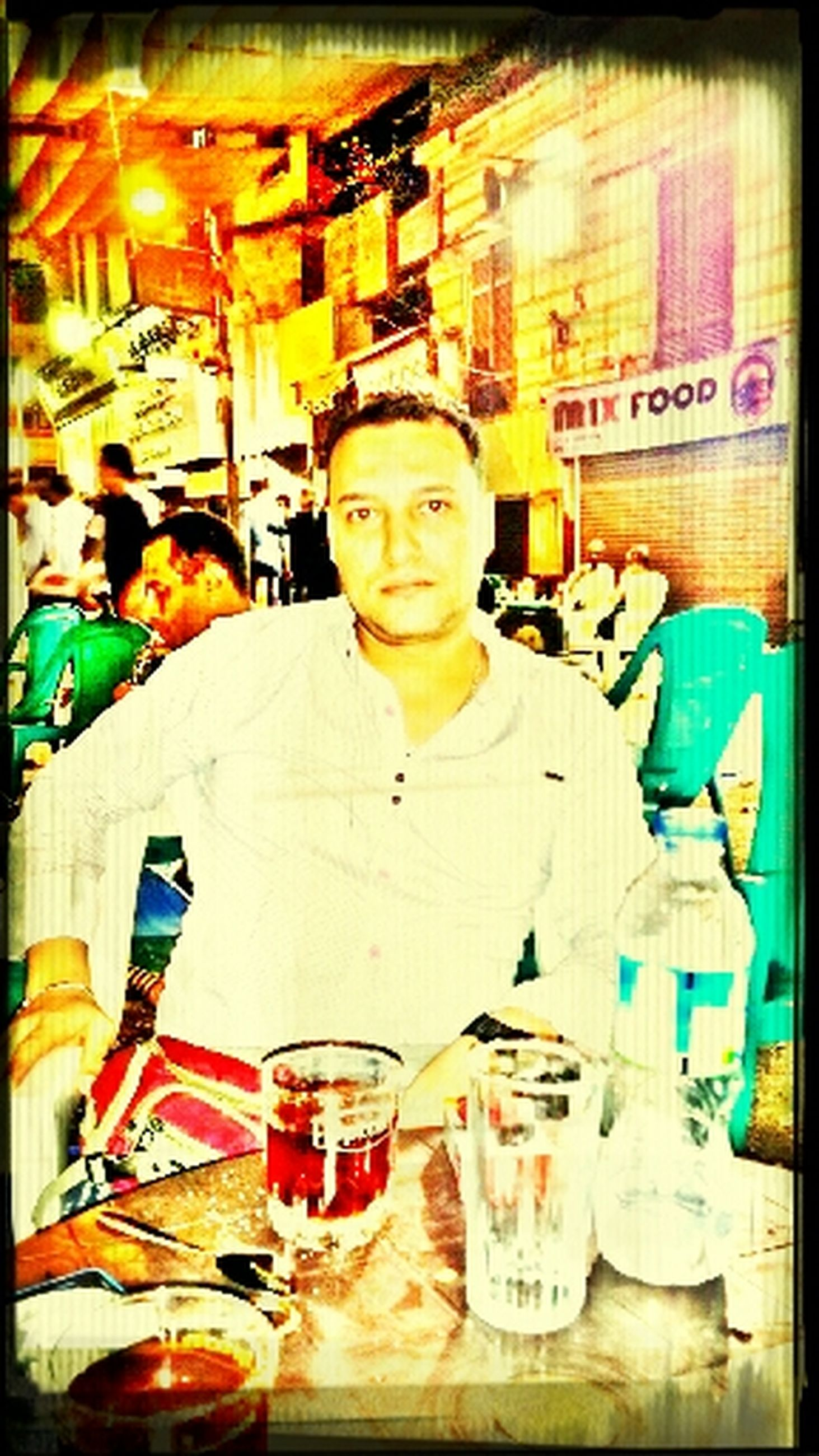 indoors, transfer print, food and drink, drink, auto post production filter, lifestyles, casual clothing, front view, leisure activity, human representation, person, refreshment, incidental people, food, looking at camera, store, restaurant, sitting