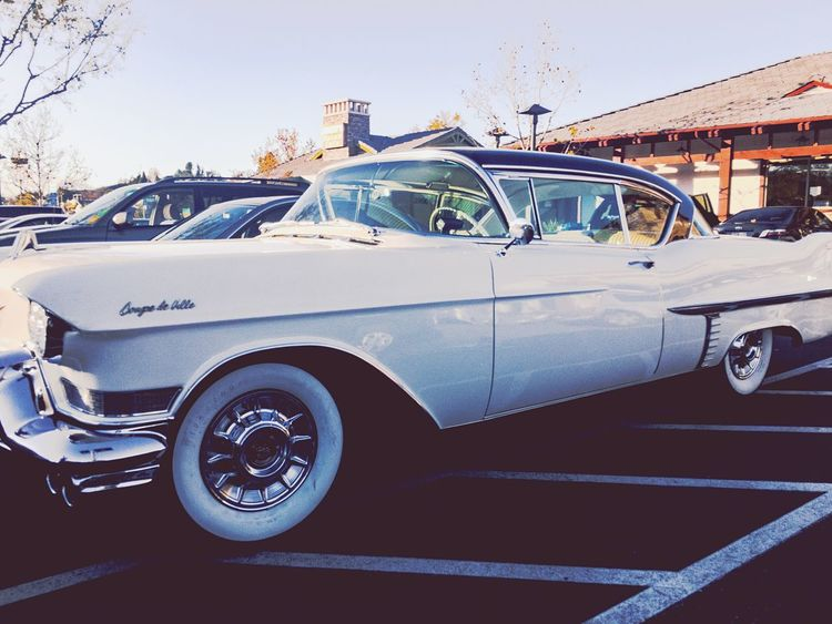 Car Cadillac Coupe De Ville Land Vehicle Transportation Mode Of Transport No People Day Outdoors Clear Sky Road Sky Architecture Classic Classic Car White Wall