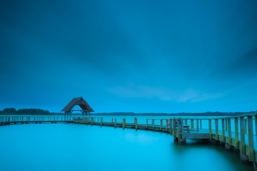 Storm Sebastian. 480 Seconds exposure with heavy wind around eight beaufort.Autumn Fresh On Eyeem  Hemmelsdorfer See Storm The Week On EyeEm Architecture Blurred Motion Built Structure Day Lake Lake View Landing Stage Lee Filters Long Exposure Moving Clouds Nature No People Outdoors Reed Sea Sky Sturmtief_sebastian Water Betterlandscapes Landscape An Eye For Travel