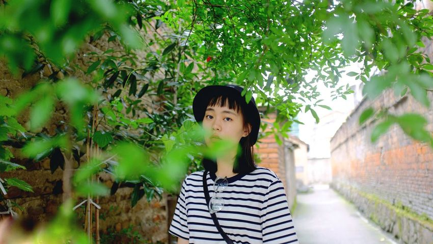 Striped One Person Casual Clothing Black Hair Young Adult Real People Day Lifestyles Tree Standing Growth Outdoors EyeEmNewHere EyeEmNewHere