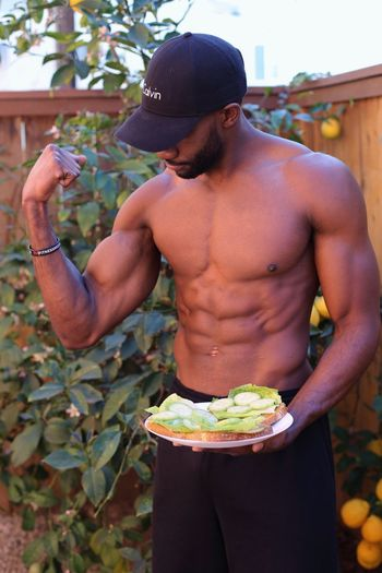 Vegan Health Holding Shirtless One Person Real People Food And Drink Lifestyles Food Adults Only Only Men Outdoors Young Adult One Man Only Standing Men Day Adult People