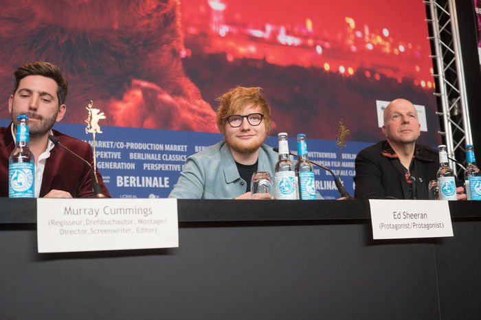 Berlin, Germany - February 23, 2018: English director Murray Cummings and singer, guitarist Ed Sheeran with host Anatol Weber attend the 'Songwriter' press conference at 68th Berlinale 2018 Ed Sheeran Famous Film Festival Interview Premiere Press The Media Anatol Weber Berlinale Berlinale 2018 Berlinale Festival Berlinale2018 Berlinale68 Documentary Film Edsheeran Festival Film Industry Frontal View Mass Media Murray Cummings Press Conference Songwriter