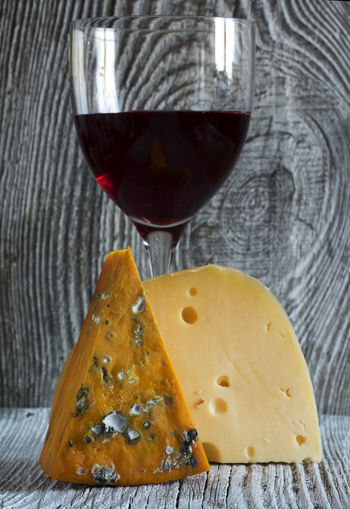 Fresh pieces of cheese (Mozzarella, roquefort, Maasdam) and wine on old wooden weathering background Alcohol Appetizer Background Cheese Close-up Cracker Drink Drinking Glass Food Food And Drink Fresh Freshness Indoors  Maasdam Mozzarella No People Old Pieces Red Wine Roquefort Weathering Wine Wineglass Wooden