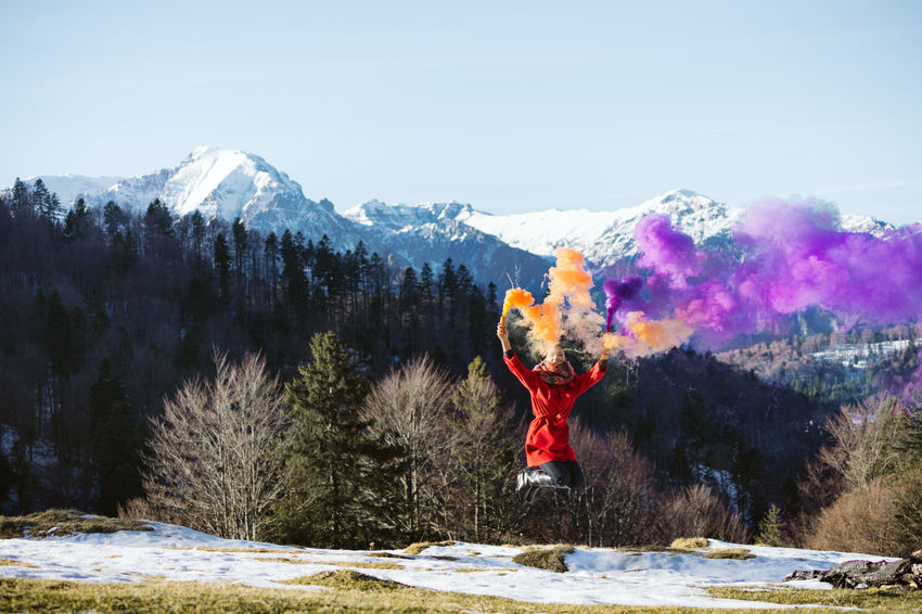 Nature Jump Jumping One Person One Woman Only Women Smoke Smoke - Physical Structure Smoke Bomb People Colors Colours Mountain Range Tree Mountain Snow Cold Temperature Winter Skill  Forest Full Length Pinaceae Pine Tree Snowcapped Mountain Mountain Peak A New Perspective On Life