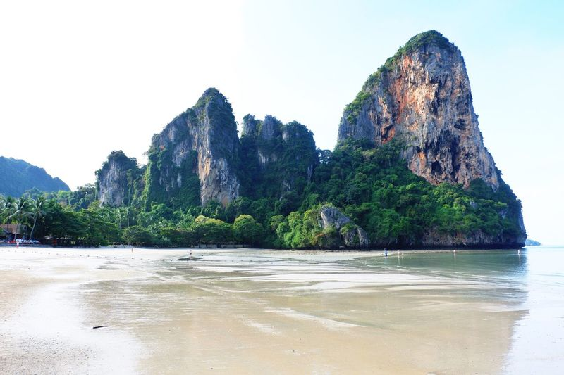 Rock mountain at Railey beach, Krabi, Thailand Rest Relax Krabi Thailand Railey Beach Travel Destinations Landscape Landmark Rock - Object Sea Rock Formation Nature Scenics Beauty In Nature Mountain Beach Sand Outdoors Clear Sky Day