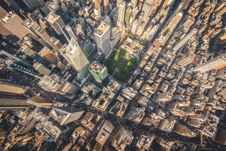 Wide angle photograph of the New York City's downtown shot from a helicopter. American Bird Eyes View Helicopter High Rise Manhattan NYC New York City Roof Rooftop Skyscrapers Sunny USA Aerial America Building Gigantic Helicopter View  Park Street Sunset Towers Unique Vertigo Wide Angle