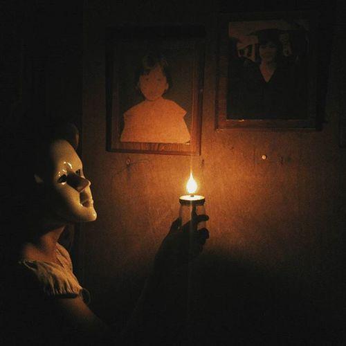 Lit candle in darkroom